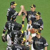 Reason to smile: The Fukuoka Softbank Hawks beat the Chunichi Dragons for the second straight day, winning 2-1 on Wednesday at Nagoya Dome. | KYODO PHOTO