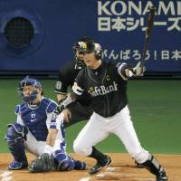 Role model: Hawks captain Hiroki Kokubo, seen delivering a first-inning single in Game 4 of the Japan Series on Wednesday, fills a valuable role for his team on and off the field. | KYODO