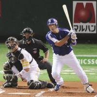 Early momentum: Dragons slugger Kazuhiro Wada smacks a two-run, first-inning triple against the Hawks in Game 6 of the Japan Series on Saturday at Yahoo Dome. Chunichi defeated Fukuoka Softbank 2-1. | KYODO PHOTO