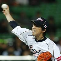 Positive impression: Kenta Maeda gives Samurai Japan fans a satisfactory performance on Sunday, holding China to one hit in five scoreless innings in the teams' World Baseball Classic game in Fukuoka. Japan beat China 5-2. | AP