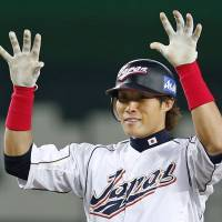 Weekend fun: Japan right fielder Yoshio Itoi reacts after hitting an RBI double in the fifth inning of Sunday's WBC game against China at Fukuoka Dome. | AP