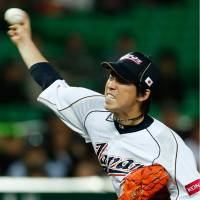 Maeda regains pitching form, holds China scoreless for five innings