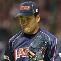 Short circuit: Starting pitcher Masahiro Tanaka lasted only two innings of Japan's World Baseball Classic-opening 5-3 win over Brazil on Saturday.   AFP-JIJI