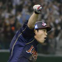 Hirokazu Ibata reacts after driving home the game-tying run in the top of the ninth.   | KYODO