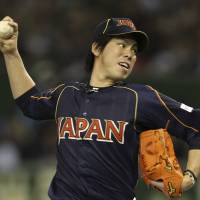 Easy does it: Japan starter Kenta Maeda delivers a pitch against the Netherlands at Tokyo Dome on Sunday night. | AP