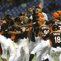 Dutch treat: Players from the Netherlands celebrate after their 7-6 sayonara victory over Cuba in their second-round game at the World Baseball Classic at Tokyo Dome on Monday night. | AP