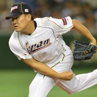 World fair: Right-hander Masahiro Tanaka is one of several Japan players drawing interest from major league scouts at the 2013 World Baseball Classic. | AFP-JIJI