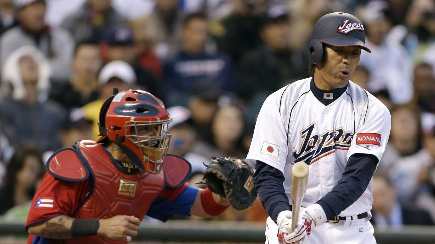 Over and out: Atsunori Inaba strikes out during the third inning of Japan's 3-1 World Baseball Classic semifinal defeat to Puerto Rico in San Francisco on Sunday.