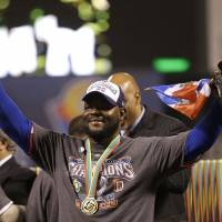 Bearing fruit: Dominican Republic reliever Fernando Rodney holds up a plantain as he celebrates his country's 3-0 win over Puerto Rico in the final of the World Baseball Classic on Tuesday. | AP