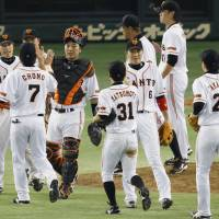 Business as usual: The Yomiuri Giants open the 2013 season with a 4-3 victory over the Hiroshima Carp on Friday at Tokyo Dome. | KYODO