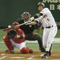 Early advantage: The Giants' Jose Lopez smacks a solo home run in the third inning.   KYODO