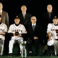 Honoring the champions: Former Yomiuri Giants legends, including Shigeo Nagashima (front, third from left), join current skipper Tatsunori Hara, catcher Shinnosuke Abe (rght) and pitcher Tetsuya Utsumi (left) in a pregame ceremony as 2012 Japan Series championship rings are distributed. | KYODO
