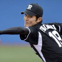 Youth movement: Hanshin rookie Shintaro Fujinami pitches during the Tigers' 2-0 loss to the Swallows on Sunday. | KYODO