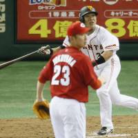 Never say die: Yomiuri's Ryota Wakiya hits a game-tying double in the 11th inning of the Giants' 3-2 win over the Carp at Tokyo Dome on Sunday. | KYODO