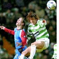 Celtic midfielder Shunsuke Nakamura competes for the ball during a Scottish Premier League match against Inverness Caley Thistle.