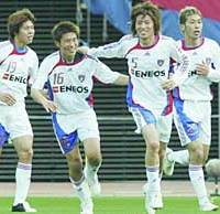 FC Tokyo defender Tatsuya Masushima (second from right) smiles after scoring the tying goal in the 89th minute against Yokohama F. Marinos on Saturday.