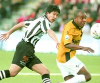 Sota Hirayama of SC Heracles Almelo competes for the ball during a match against NAC Breda in the Dutch first division.