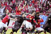 Urawa Reds players celebrate victory in the AFC Champions League semifinal on Wednesday at Saitama Stadium. Urawa won 5-3 in the shootout after the game finished 2-2 on the night as the Reds kept their dreams alive of winning the quadruple of the ACL, J. League, Emperor's Cup and Club World Cup. | KYODO PHOTO