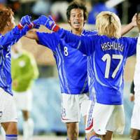 Japan under-22 midfielder Keisuke Yoshida (8) celebrates with his teammates after Japan qualified for the 2008 Beijing Olympics after an 0-0 draw with Saudi Arabia in their Asian qualifying match on Wednesday at Tokyo's National Stadium. | KYODO PHOTO