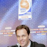 Reds coach Holger Osieck smiles while speaking at a Tokyo news conference for the FIFA Club World Cup on Wednesday.   KYODO PHOTO