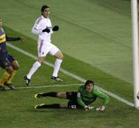 AC Milan forward Kaka scores past Boca 'keeper Mauricio Caranta for his team's third goal in the Club World Cup final in Yokohama on Sunday evening. Kaka also set up two goals for Filippo Inzaghi in the 4-2 victory. | AP PHOTO