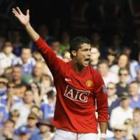 Still in Red: United's Cristiano Ronaldo reacts during the Red Devils' match against Chelsea on Sunday in London.