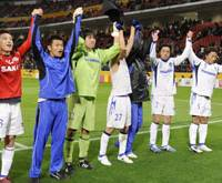 Gamba Osaka players show their appreciation to the crowd after beating Adelaide United 1-0 Sunday. | KYODO PHOTO