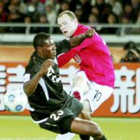 Clutch performer: Manchester United's Wayne Rooney (10), who was named the Club World Cup's top player, finishes with the match-winning goal in the 1-0 tournament final on Sunday at International Yokohama Stadium.   KYODO PHOTOS