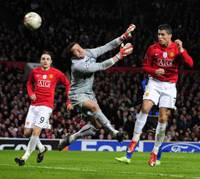 Goal machine: Manchester United's Cristiano Ronaldo (right) heads the ball past Inter Milan 'keeper Julio Cesar for a goal as teammate Dimitar Berbatov looks on in Champions League action at Old Trafford on Wednesday. Man United won 2-0. | AP PHOTO