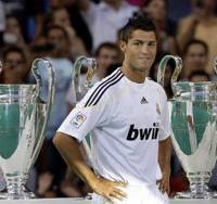 Welcome party: Cristiano Ronaldo poses with Real Madrid's trophies during his official presentation before 80,000 fans at Santiago Bernabeu Stadium on Monday. | AP PHOTO