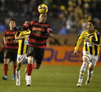 Nerves of steel: Pohang Steelers' Denilson chases the ball in the Asian Champions League final at Tokyo's National Stadium on Saturday. Pohang beat Saudi Arabia's Al Ittihad 2-1. | AP PHOTO