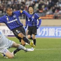 On target: Gamba Osaka forward Lucas (9) scores his second goal against second-division champion Vegalta Sendai in the Emperor's Cup semifinals on Tuesday. Gamba defeated Vegalta 2-1.   KYODO PHOTO