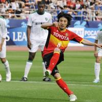 On target: Grampus midfielder Jungo Fujimoto scores in the 77th minute on a penalty kick in an Asian Champions League match against Hangzhou Greentown on Wednesday. Nagoya won 1-0. | KYODO