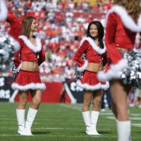 Jingle belles: Tomoko Kojima is now a cheerleading captain at the Tampa Bay Buccaneers having entered her eighth year with the NFL team. | MAKOTO SATO