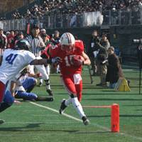 No letup: Japan wide receiver Shoei Hasegawa crosses the goal line for a second-quarter touchdown after catching a pass in Saturday's game against South Korea. | KAZ NAGATSUKA