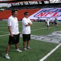 Ryoma Hagiyama (left) and Sojiro Kido watch a practice session for the Pro Bowl on Saturday at Aloha Stadium. | KAZ NAGATSUKA