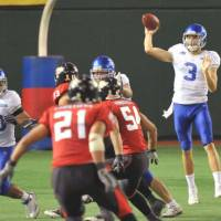Go long: Kevin Craft plans to make the most of his time as the quarterback of the X League's IBM BlgBlue. | YOSHIAKI MIURA