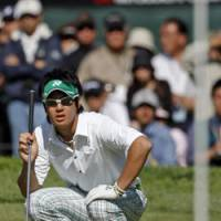 Coming up short: Ryo Ishikawa lines up his shot from the fringe on the 10th hole during the second round of the Northern Trust Open on Friday. Ishikawa shot a 71 but missed the cut. | AP PHOTO