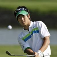 Work time: Ryo Ishikawa chips to the third green in the third round of the Transitions Championship on Saturday in Palm Harbor, Fla. | AP PHOTO