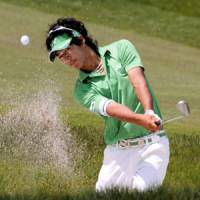 Ryo Ishikawa hits from the bunker on the 15th hole during the second round of the Japan Golf Tour Championship on Friday in Kasama, Ibaraki Pref. | KYODO PHOTO