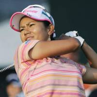 Ai Miyazato watches her shot during the first round of the U.S. Women's Open on Thursday in Oakmont, Penn. | KYODO PHOTOS