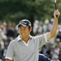 Not in the script: Yuta Ikeda celebrates victory at the ANA Open in Sapporo on Sunday. | KYODO PHOTO