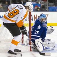 Peripheral vision: Philadelphia's Danny Briere moves in for a shot as Toronto goalie Jean-Sebastien Giguere looks on Thursday night. The Flyers beat the Maple Leafs 4-1. | AP PHOTO