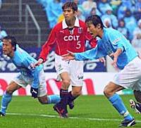 Toshiya Fujita (left) of Jubilo scores in the 59th minute to give Iwata a 1-0 win over the Urawa Reds in Saturday's J. League Division One game.