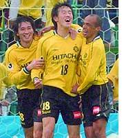 Reysol forward Kisho Yano (center) is congratulated by his teammates after scoring a goal in the 44th minute against Cerezo Osaka.
