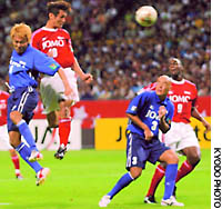 East forward  Choi Yong Soo (10) heads the ball to shoot during the first half of 2003 J. League All-Star Game on Saturday at Sapporo Dome. The East won 3-1.