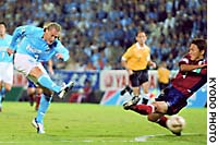 Jubilo Iwata's Gral shoots past Kashima defender Go Oiwa during a Nabisco Cup semifinal, second-leg match.