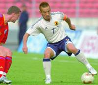Japan midfielder Hidetoshi Nakata battles Romanian defender Flavius Stoican for control of the ball during the first half of their international friendly in Bucharest on Saturday. The match ended in a 1-1 draw.