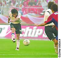 Tatsuya Tanaka of the Reds scores the third goal of the Nabisco Cup final against the Kashima Antlers at Tokyo's National Stadium.