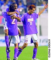 Sanfrecce forward Genki Nakayama celebrates with his teammates after the second division-side secured promotion with a 2-1 win over Sagan Tosu on Saturday in Hiroshima.